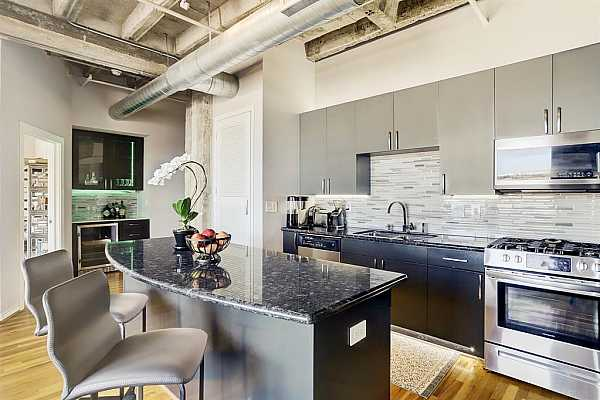 Photo #8 The recent renovation included upscale stainless steel appliances which include a gas range, dishwasher, freezer-bottom refrigerator, and there