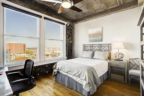 Photo #10 Enjoy wide-open views in this expansive space that can easily accommodate a guest room and home office area.