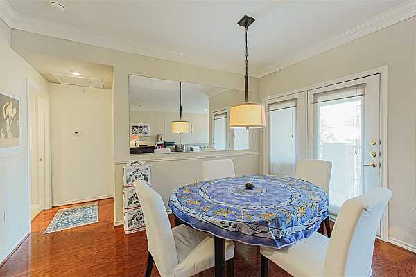 Photo #6 dining room to terrace balcony with Mccue Road view of Williams Tower