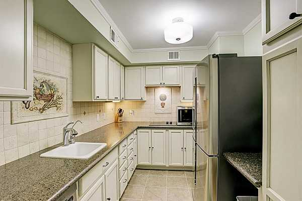Photo #12 KITCHEN offers granite counter tops and ample counter and cabinet space.