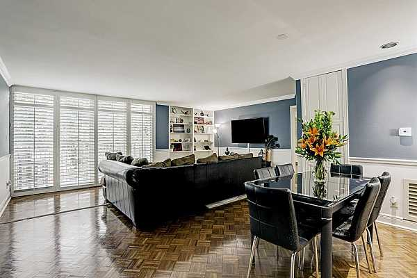 Photo #5 Open LIVING / DINING ROOM is light and bright with floor to ceiling windows for lots of natural light; beautiful parquet floors throughout.