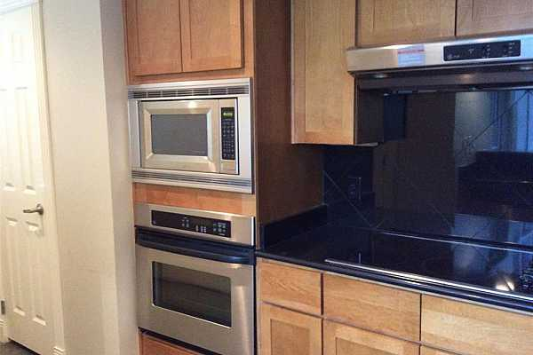 Photo #12 Kitchen with Stainless Steel Appliances and Granite Counters.
