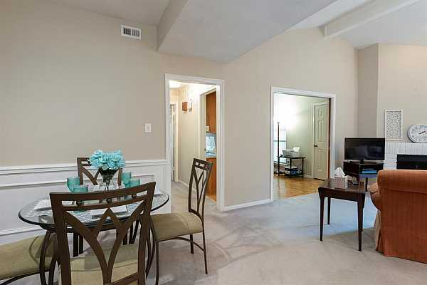 Photo #11 Large, open living spaces with custom trim and vaulted/ beamed ceiling