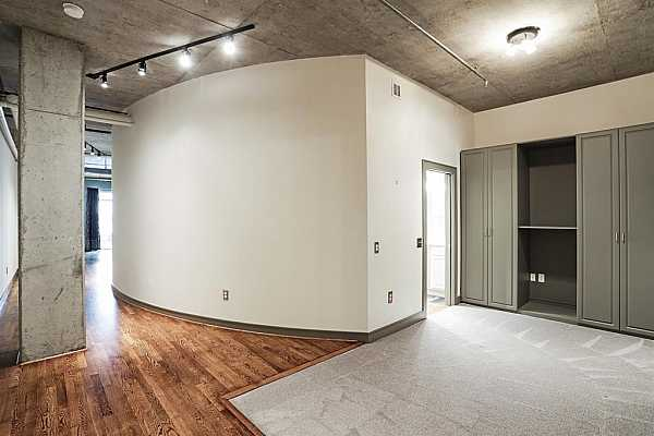 Photo #8 Light fills the living area through sliding glass door that lead to the private balcony
