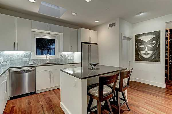 Photo #12 Storage will never be a concern in this stunning kitchen featuring 25 cabinets with 13 drawers, including a large island with deep drawers.
