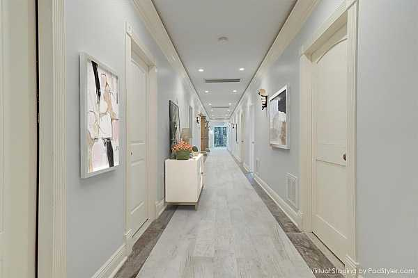 Photo #4 Virtually staged View to the gallery foyer. The study is through the double doors on the left.