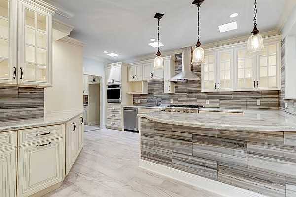 Photo #8 Kitchen with stainless appliances and natural stone counter tops