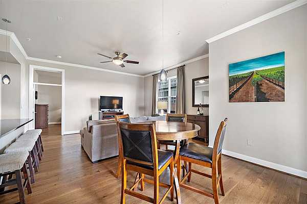 Photo #9 Natural light adds a warm ambiance to the entire area, creating an ideal space for drinking your morning coffee.