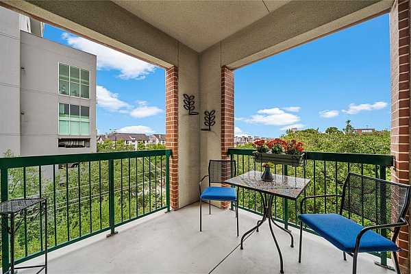 Photo #10 With plenty of room for an outdoor sitting/dining area, this balcony is ideal for entertaining guests with refreshing views of the lush greenery. The area can also be home to your potted plants and outdoor decor.