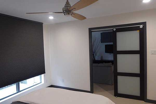 Photo #11 From Bedroom looking out through Stylish Glass Sliding Doors.