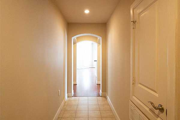 Photo #12 archways dividing entry & the rest of the condo