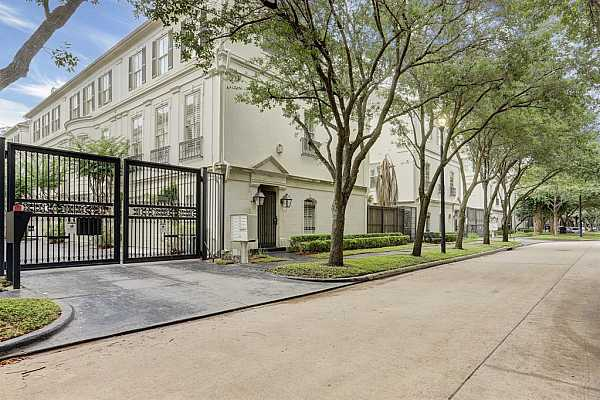 Photo #1 Gated entrance into motor court of this small group of beautiful townhomes, with exterior gas lamps, on a lovely tree lined street.  Conveniently located close to everything that makes Houston a great place to live and work. Two parks nearby for your dogs!
