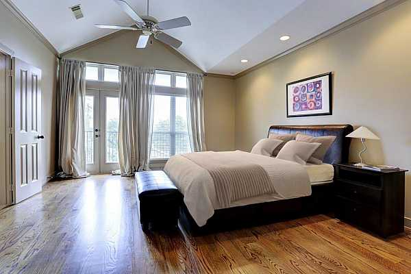 Photo #12 Third floor: Master retreat with vaulted ceilings, hardwoods, and access to private balcony.