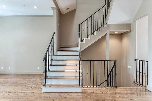 Photo #8 This beautiful staircase creates the perfect focal point.