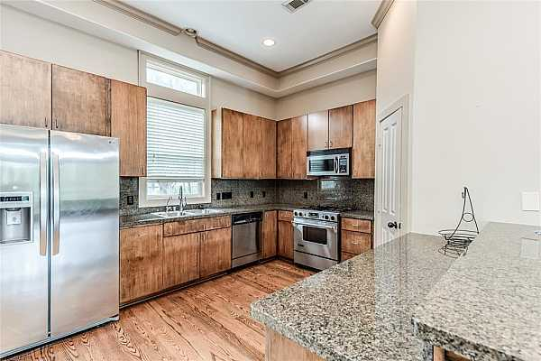 Photo #10 Kitchen with gas range, walk in pantry, and abundant counter prep space.