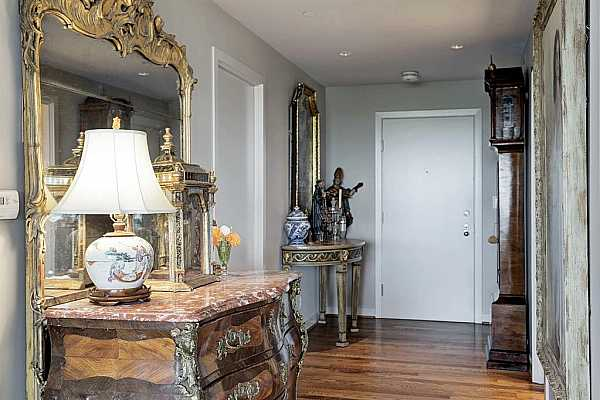Photo #12 Beautiful spacious entry leads to spacious apartment with wood floors throughout the entertaining spaces.