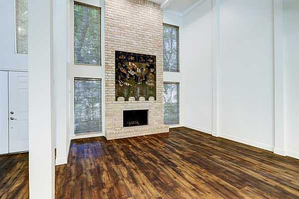 Photo #9 Large stone fireplace in living area.