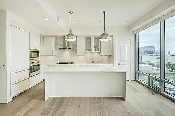 Photo #5 Stunning kitchen with porcelain counters and backsplash, Wolf gas cooking, Sub-Zero refrigeration with separate wine refrigerator and SieMatic cabinetry.