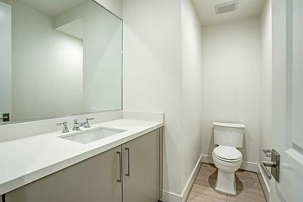 Photo #8 Nice size powder room, tucked in the hall, away from the living room and kitchen.