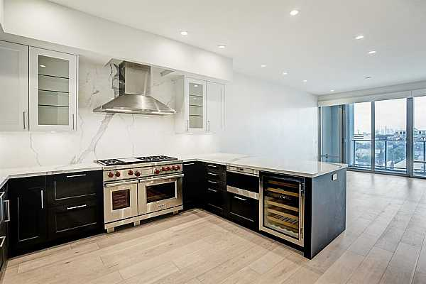 Photo #1 Welcome to The Wilshire. A full-service high rise within walking distance to River Oaks District.