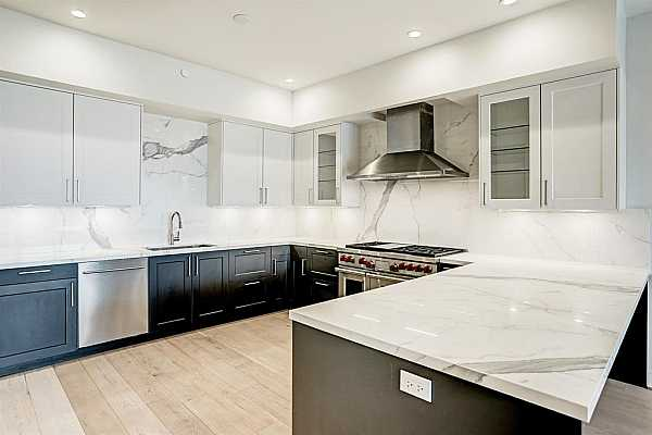 Photo #5 The kitchen in this home is stunning. The Wolf gas range offers double ovens, 6 gas burners and a griddle.  The SieMatic cabinets and Sub-Zero wine refrigerator make this space not only functional but also luxurious.