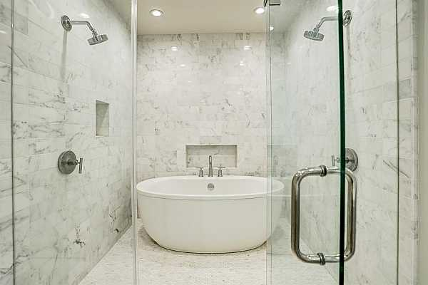 Photo #10 The luxurious primary bath offers SieMatic cabinetry and a very large shower with free standing tub.