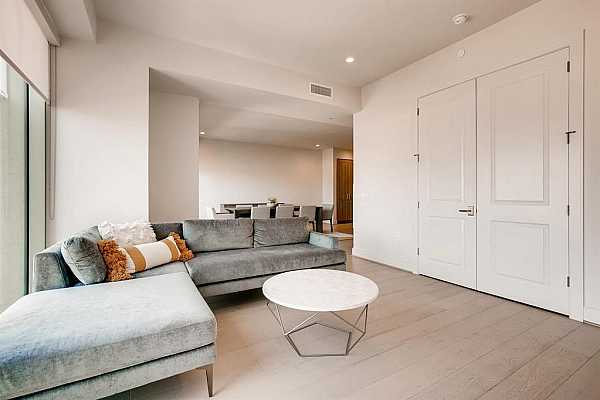 Photo #6 Open concept floor plan with gorgeous hardwood flooring throughout living areas.