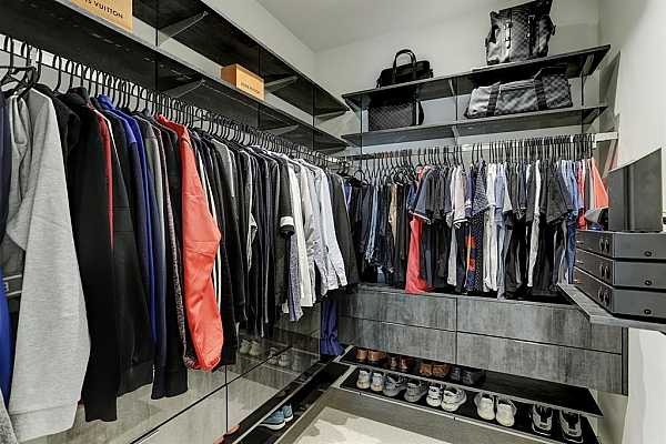 Photo #7 Primary closet featuring custom Container Store shelving. Plenty of space to hang all of your clothes and accessories.
