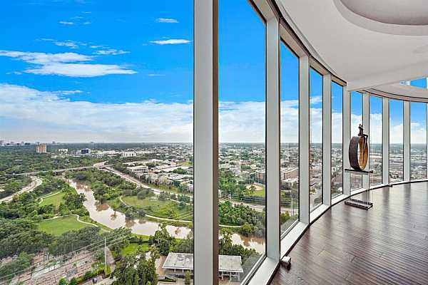 Photo #7 Floor-to-Ceiling, 180 Degree Helicopter Views of Buffalo Bayou and Beyond Wrap from the Dining Room into the Living Room.