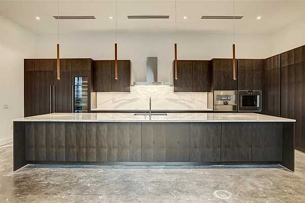 Photo #6 The gourmet kitchen is outfitted with high-performance Gaggenau appliances and Italian-imported Giorgetti cabinetry and pendants.