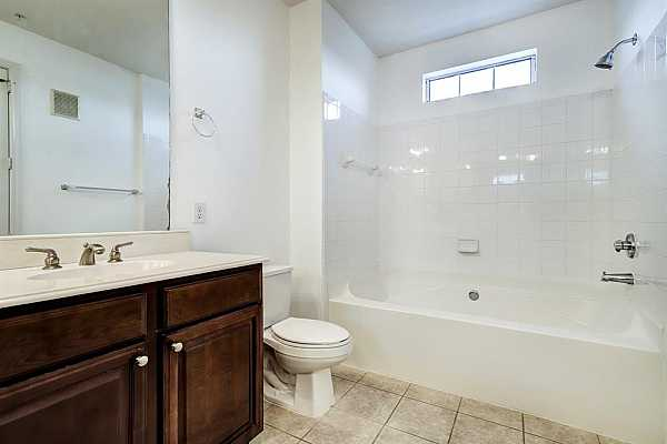 Photo #12 Primary Bath features tub with shower.