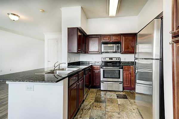 Photo #4 All-electric Kitchen with stainless steel appliances.