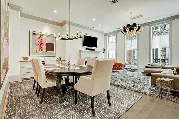 Photo #11 Open dining/living area with floor to ceiling windows w/ lots of light!