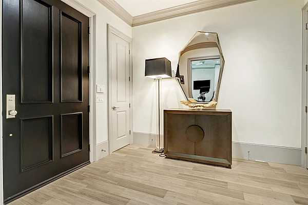 Photo #7 The spacious marble tiled entry has 10
