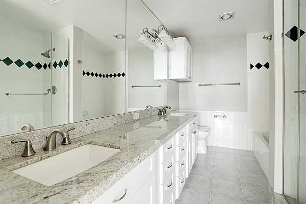 Photo #7 Primary bath with granite counters/double sinks/tub and a walk-in shower.