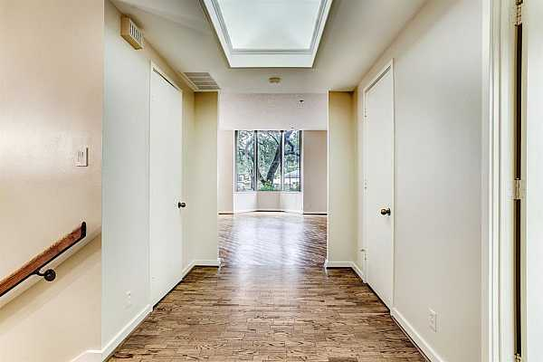 Photo #1 The 12x8 Entry Hall shows the stairs leading to the bedrooms and the lovely greenery outside.