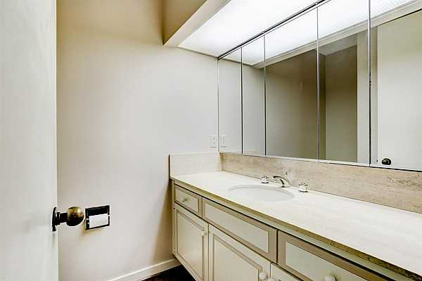 Photo #10 The Powder Room is accessible form the Entry.