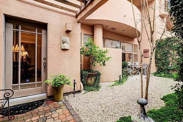 Photo #1 3265 Sul Ross.  Front gated courtyard that offers garden views to the rooms indoor.