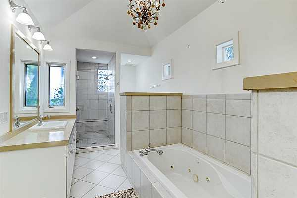 Photo #12 Primary bath with double sinks, bathtub, and separate shower.