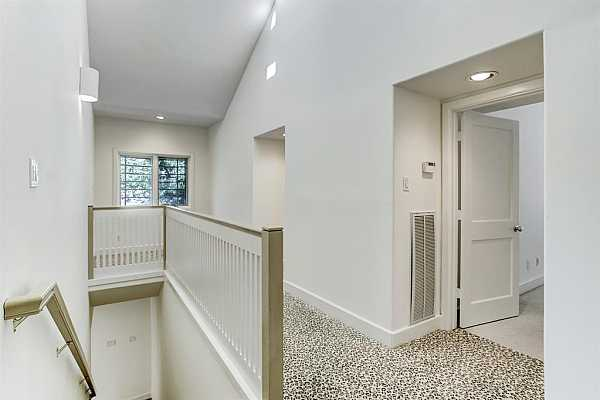 Photo #10 Upstairs landing with cozy sitting area or office space at the end