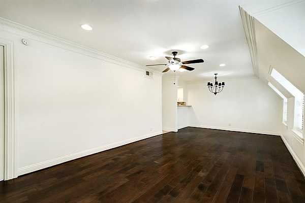 Photo #4 Look at this living/dining room. It is huge! This condo boasts loads of natural light and fabulous wood floors. All with a fresh coat of paint!