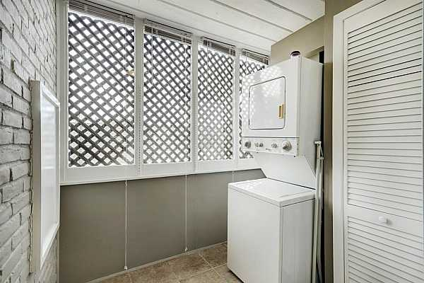 Photo #9 The laundry room is enormous with plenty of storage space.