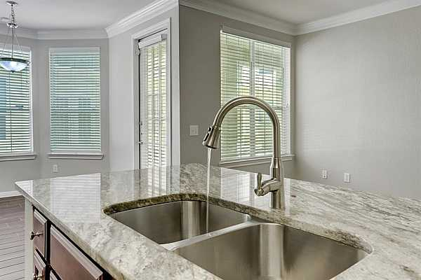 Photo #6 The kitchen granite counters are upgraded and a very lovely neutral color