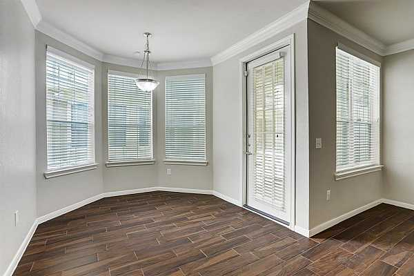 Photo #9 The dining room looks onto to a courtyard, and this unit has a nice fenced in patio