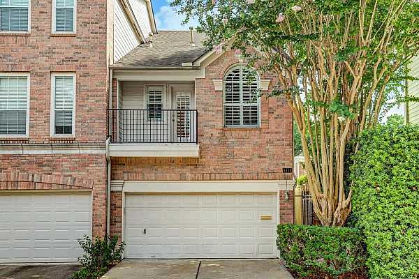 Photo #1 This 3-story end unit townhome in a gated community is an affordable sanctuary in the heart of the city.