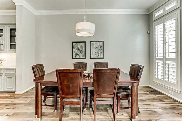 Photo #12 Enjoy meals together in this large dining room with convenient proximity to the kitchen and living room