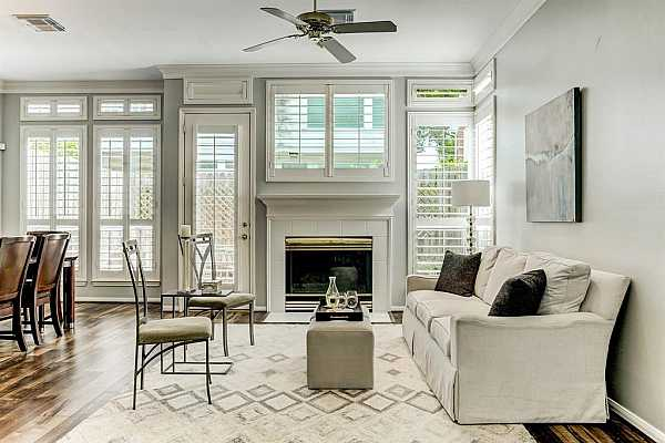 Photo #8 High ceilings, crown molding, laminate floors and recently installed plantation shutters give this townhome an elegant and contemporary feel.