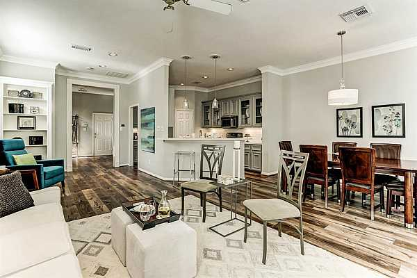 Photo #9 The open concept with the spacious living room, sizeable dining room, and newly renovated kitchen make this home perfect for those who enjoy practicing hospitality