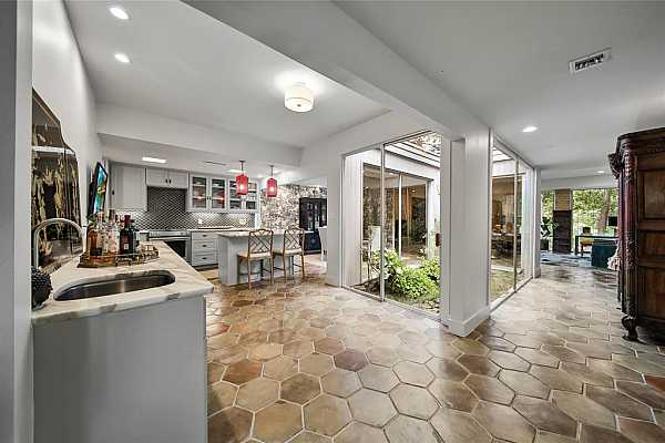 Photo #8 The floor plan effortlessly flows from entry to entertaining areas.