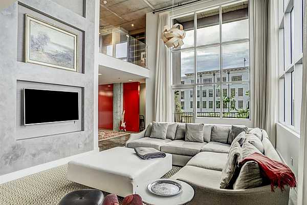 Photo #3 Sprawling windows in the living space with views of the Sophie on one side and Memorial on the other!